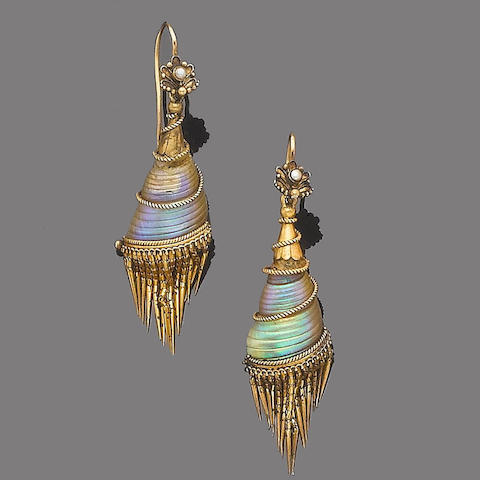 A pair of shell and gold earrings,