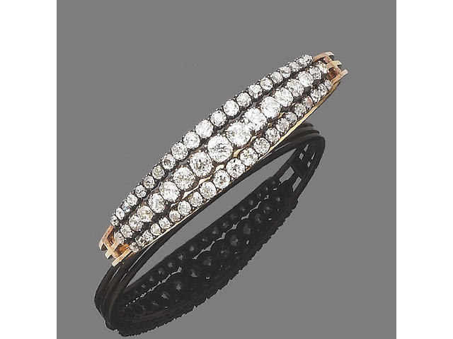 A late 19th century diamond hinged bangle