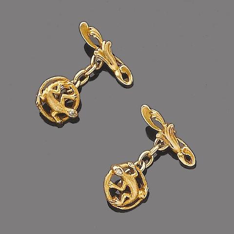 A pair of diamond-set cufflinks,