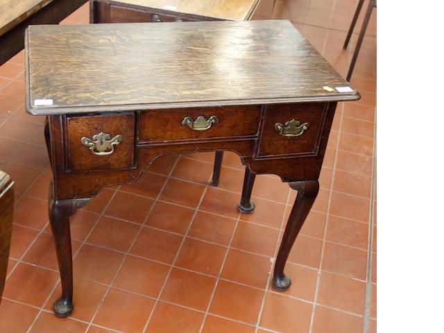 A George III oak lowboy,