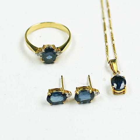 A sapphire and diamond ring, earring and pendant necklace suite