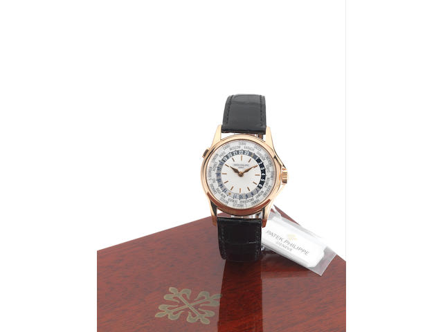 Patek Philippe. A fine 18ct pink gold automatic World Time wristwatchRef:5110R, Case No.4153090, Movement No.3209343, Sold April 2002.