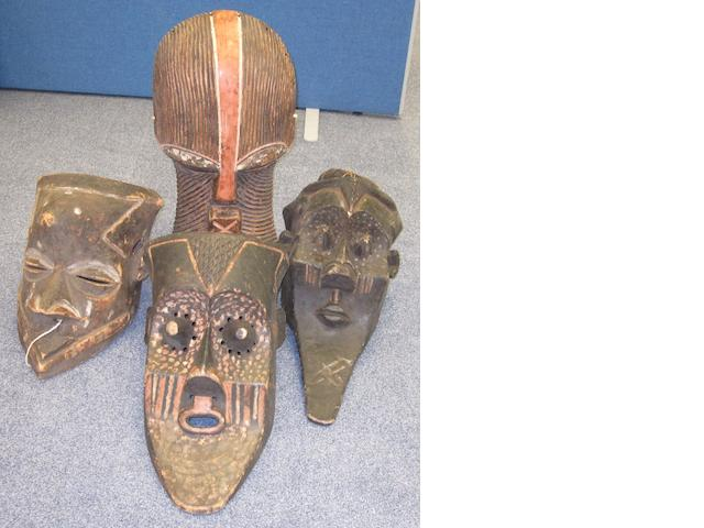 Four African masks largest 55cm 4