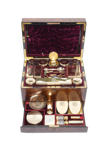 A Victorian walnut and brass bound dressing case, the majority of the silver-gilt fittings by George Betjeman & Sons, London 1875 and later retailed by Hartman, London 1924,