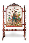 A mid Victorian walnut firescreen display of exotic birds by Ashmead & Co.