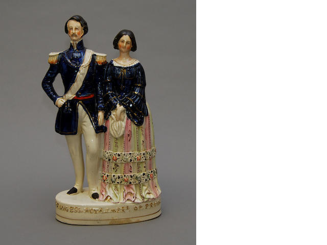 A large Staffordshire figure of Victoria and Albert