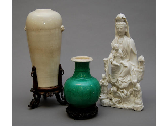 Two Oriental vases and a blanc-de-chine figure