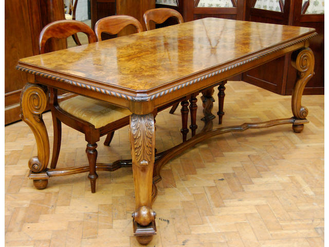 A figured walnut and walnut dining table, mid-20th Century