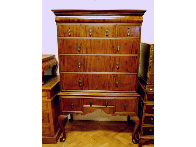 A walnut chest on stand, in early 18th Century style