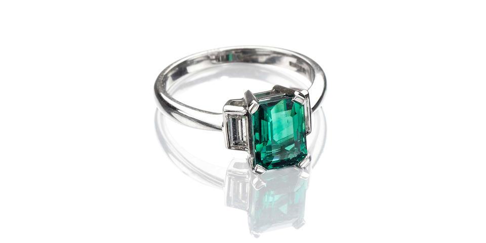 A fine emerald and diamond three-stone ring