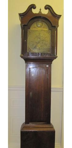 "John Taylor, Manchester - an 18th Century longcase clock, the 12"" brass broken arch dial, with month engraved chapter and Roman numerals interspaced with city names, twin train movement striking on a bell contained in a mahogany case, pendulum and weights."