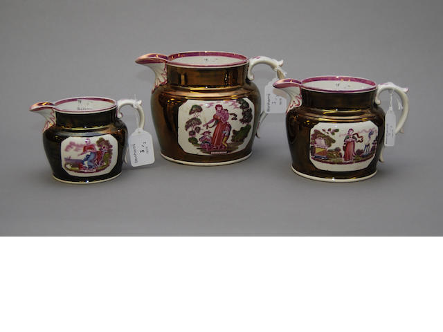 A graduated set of three lustre jugs