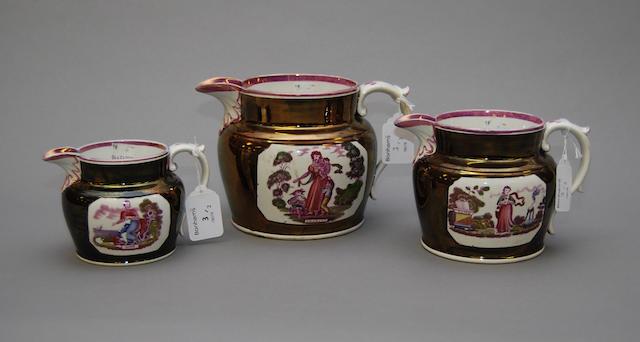 A graduated set of three lustre jugs