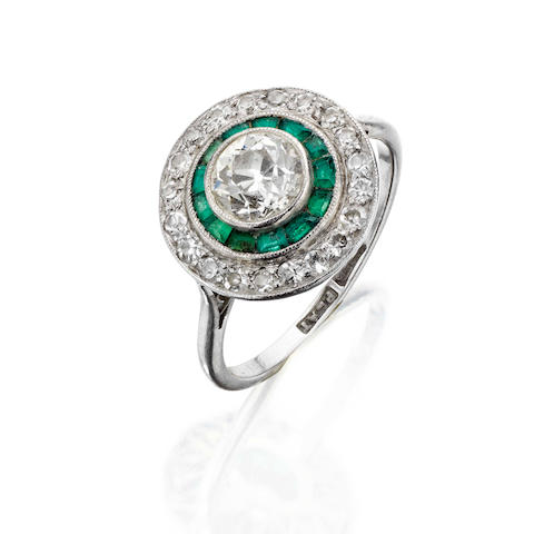An early 20th century emerald and diamond target ring