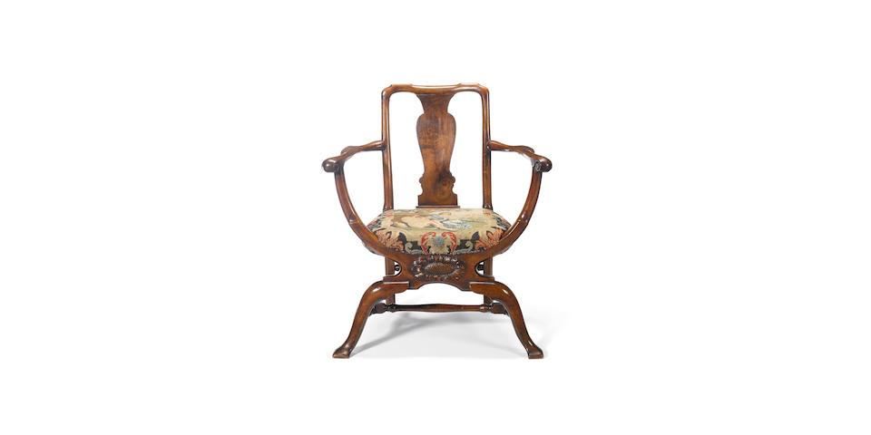 An unusual George I walnut X-frame library armchair