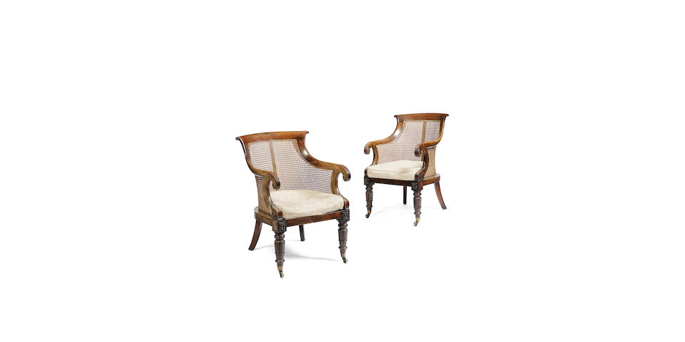 A pair of William IV rosewood and simulated rosewood library bergeres