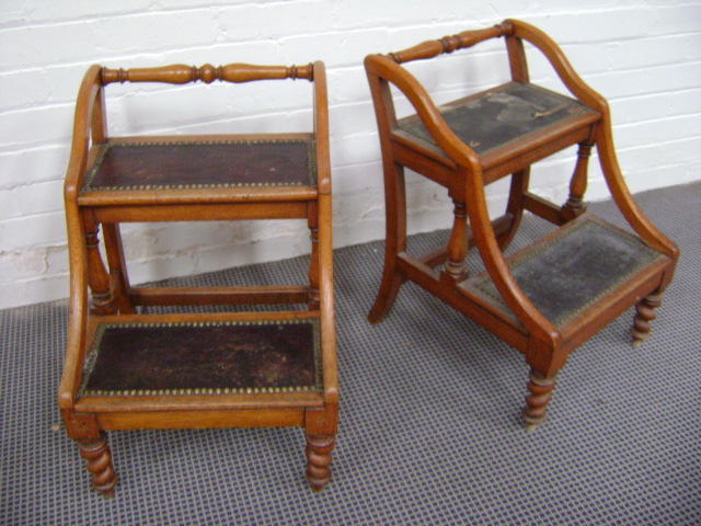 Two sets of oak library steps,