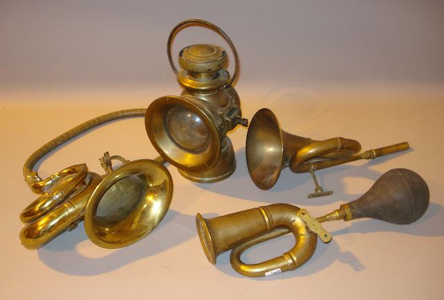 A Lucas 'King of the Road' brass lamp and three horns,