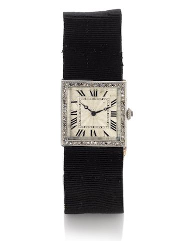Cartier. A fine and rare lady's platinum and diamond set cocktail watch 1920's