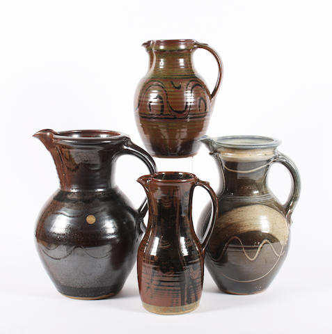 A large jug by Hugh Veater, another by Michael Casson and two Winchcombe pottery jugs