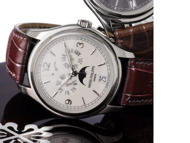 Patek Philippe. A very fine 18ct white gold automatic centre seconds wristwatch with annual calendar, moon phases and 48 hour power reserve, together with Certificate of Origin and fitted wooden box Annual Calendar, Ref:5146G, Case No.4418154, Movement No.3604913, Sold by Wempe, London on the 20th December 2007