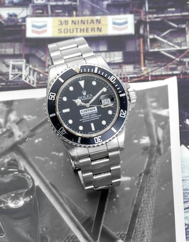 Rolex. A rare stainless steel automatic centre seconds divers watch made for Comex together with divers log books, rare photographs and other related materialSubmariner, 'Comex 6150' Ref:16800, Serial No.8274602, 1984