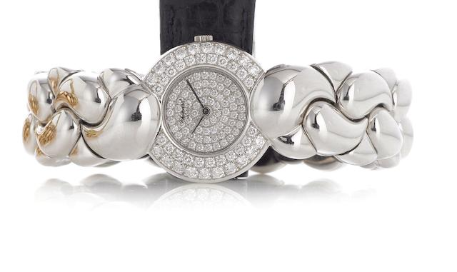 Chopard. A lady's fine 18ct white gold diamond set quartz bracelet watch Casmir, Model number 480842, Recent