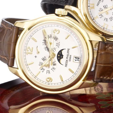 Patek Philippe. A fine 18ct gold automatic centre seconds wristwatch with annual calendar, moon phases and 48 hour power reserve, together with Certificate of Origin and fitted wooden boxAnnual Calendar, Ref:5146J, Case No.4366268, Movement No.3420928,  Sold May 21st 2007