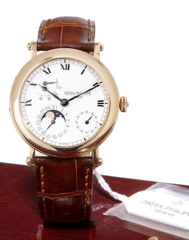 Patek Philippe. A fine 18ct rose gold automatic wristwatch with moonphases, power reserve and Certificate of Origin Ref:5054R-001, Case No.4147180, Movement No.3166017, Sold 14th December 2001