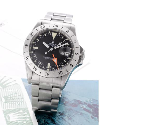 Rolex. A fine stainless steel centre seconds automatic wristwatch with 24-hour bezel and orange hand together with the original punched guarantee papers Explorer II, Ref:1655, Case No.3804487, Sold 15th December 1976