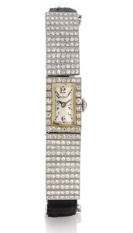 Patek Philippe. A fine and rare lady's platinum and diamond set cocktail watch together with an Extract from ArchivesCase No.601340, Movement No.806174,  Made in 1922, Sold February 6th, 1923