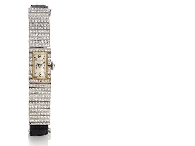 Patek Philippe. A fine and rare lady's platinum and diamond set cocktail watch together with an Extract from Archives Case No.601340, Movement No.806174,  Made in 1922, Sold February 6th, 1923