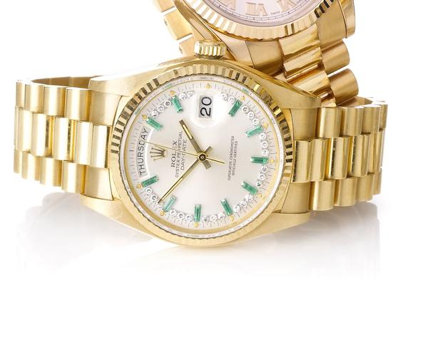 Rolex. A fine 18ct gold diamond and emerald set automatic bracelet watch Day-Date, Ref:18038, Movement No. 0525815, Case Number 6476491, 1980's