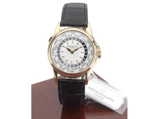 Patek Philippe. A fine 18ct pink gold automatic World Time wristwatch Ref:5110R, Case No.4153090, Movement No.3209343, Sold April 2002.