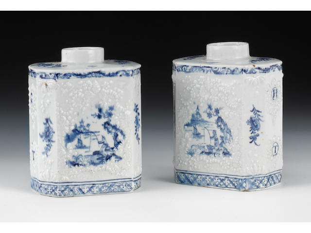 A pair of Lowestoft large tea canisters, panel moulded with Chinese scenes and initials GT and HT, covers lacking, one chipped on shoulder