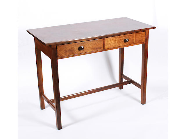 A rectangular walnut side table attributed to Peter Waals