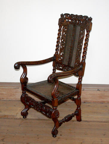 A 17th century style carved fruitwood armchair