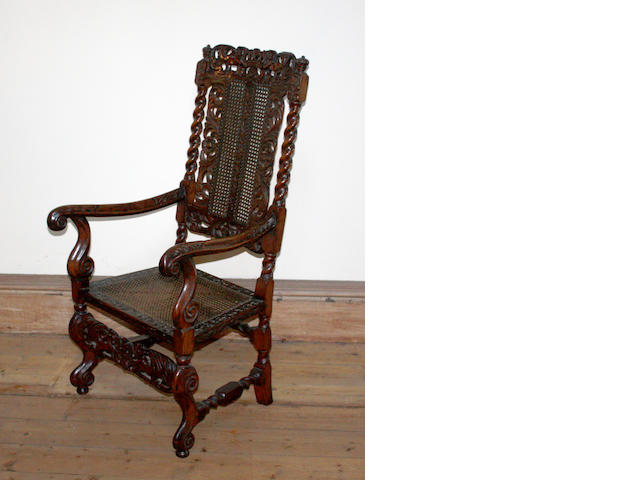 A 17th century carved fruitwood armchair