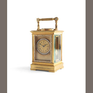 A early 20th century French paste and brass repeating carriage clock