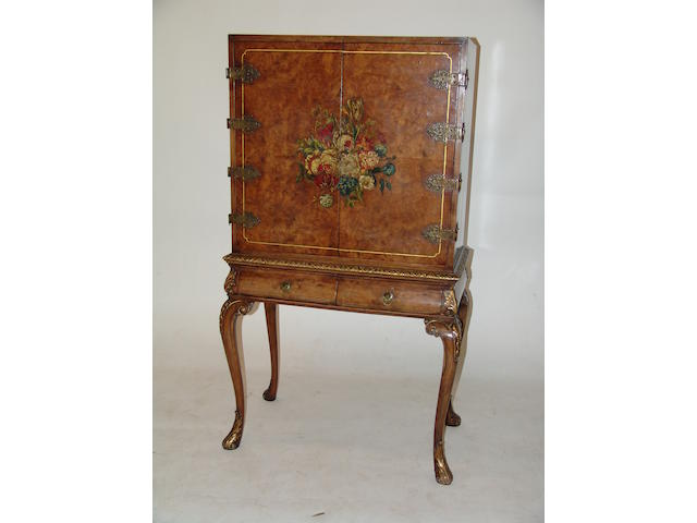 A Queen Anne revival walnut and gilt cocktail cabinet