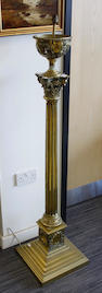 A brass Corinthian column standard oil lamp 131cm