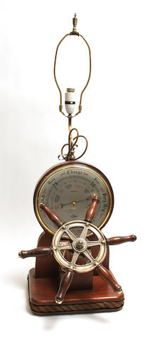 A novelty 20th century aneroid marine themed barometer lamp Shortland
