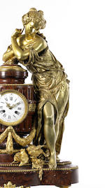 A 19th century French red griotte marble and gilt bronze clock garniture
