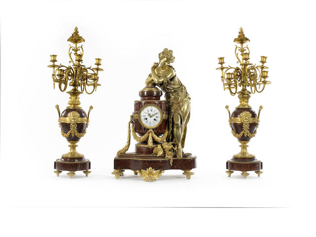A large French late 19th century red griotte marble and gilt bronze clock garnitureprobably by Houdebine, Paris
