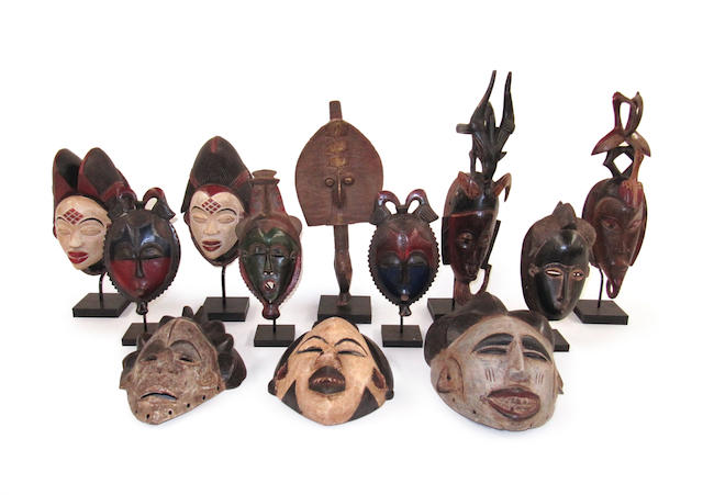 "A collection of African masks and carvings largest 37cm high (14.5"" high) 12"