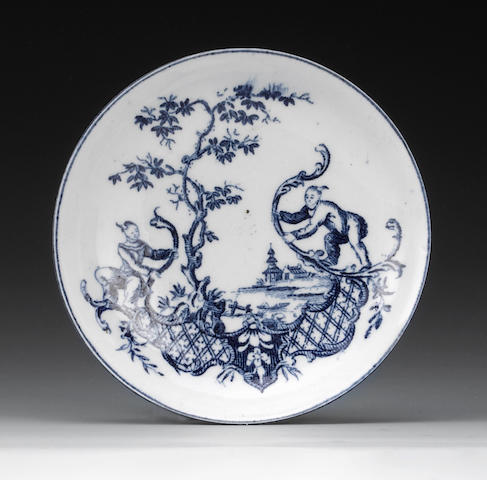 An Isleworth saucer, Chinese boys and scrollwork print
