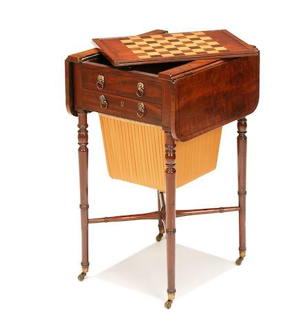 A Regency plum pudding mahogany and mahogany work/games table