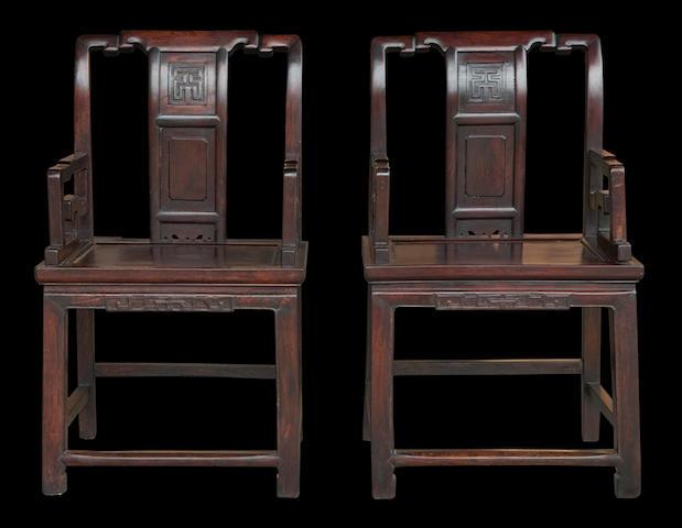 A pair of Chinese dark wood chairs 20th century