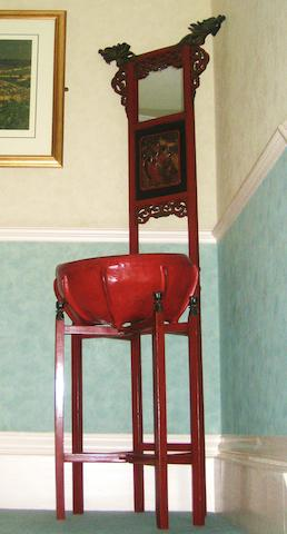 A Chinese carved wood red lacquer wash stand 20th century