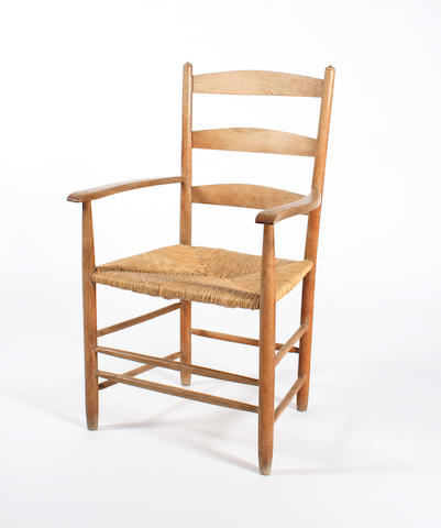 A turned ash frame ladderback open arm elbow chair by Edward Gardiner, circa 1950, designed by Ernest Gimson, 'The Bedales'